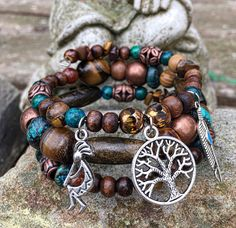 Grounded Wisdom: three wrap beaded memory wire bracelet with metal stamped charm