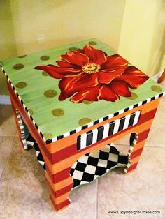 Painted Flower Table.  This would look great on my kitchen step stool