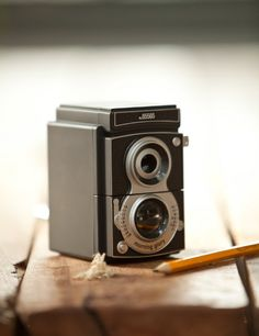 This vintage camera pencil sharpener fits every size pencil or crayon. A great addition to any desk.