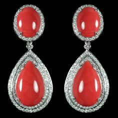 Coral & Diamond Earrings. Accompanied by 48.28 carats of Coral & 2.81 carats of Diamonds. Set in 18 karat White Gold.