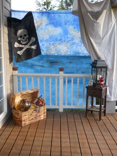 """Pirate photo backdrop--I thought it would be fun to make a vingette to take photos for my grandsons pirate birthday party. For the backdrop, I used an old white sheet and painted a sky and ocean using sea sponges and acrylic paint.  I hung the backdrop on my deck, letting it fall behind the railing.  This gave the look of standing on a ship's deck.  I then added a few """"pirate themed"""" accessories.  All the guests had fun posing in their costumes.  I then tightly cropped the photos and we…"""