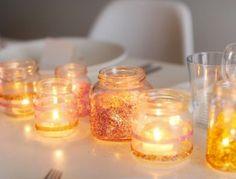 Tarros de vidrio reciclados para velas con purpurina