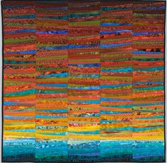 """This quilt--late summer--conveys the colors of late summer as the blues have just a touch of the coming fall. The quilt is 45x45"""" pieced and quilted using a method I call quilt as you go. The Quilts of Ann Brauer: Available works"""