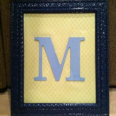 My own DIY project- bought a 16x20 frame used krylon indoor/outdoor spray paint in regal blue to paint it. For the inside covered a foam board with fabric (just used a stapler) and hot glued the letter to the board. Put it all together and now have a nice piece for my guest room!