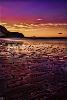 Pôr-do-sol em Aramoana, Nova Zelândia.