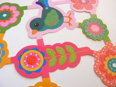 Adorable die-cut images of birds & flowers, with glitter