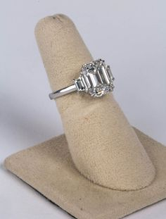 4.15 ct GIA Cert Emerald Cut F VS1 Diamond Platinum Ring | From a unique collection of vintage engagement rings at https://www.1stdibs.com/jewelry/rings/engagement-rings/