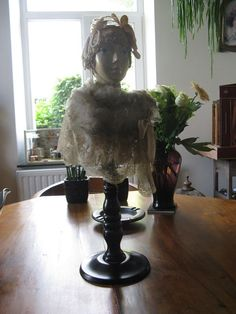 Eccentric porcelain doll with wooden base, with lace, brocade, beads and a bow #ArtNouveau
