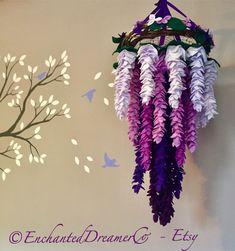 Baby Girl Nursery Themes Purple Etsy New Ideas Purple Nursery Decor, Baby Girl Nursery Themes, Boho Nursery, Nursery Chandelier, Mobile Chandelier, Hanging Flowers, Felt Flowers, Paper Flowers, Feather Mobile
