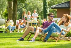 Young friends having fun at backyard barbecue party, drinking beer, talking and playing guitar on hot summer day, focus on the couple laughing sitting on deck chairs Couple Laughing, Grill Party, Picnic Time, Party Photos, Logo Nasa, Playing Guitar, Barbecue, Drinking, Have Fun