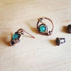 Small green onyx studs made of copper. These earrings are shaped by hand, hammered and adorned with small onyx gemstones. All my wire jewelry are treated with a special wax to protect the wire and for long lasting patina. Measurements: the diameter of the earring is 0.39inches(1cm)  Your order comes in a cute box ready to be gifted if needed.  For more wire wrapped jewelry please visit my shop www.etsy.com/shop/fromRonikwithLove