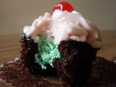 Spumoni cupcakes - chocolate cupcakes with pistachio cream filling and cherry buttercream frosting!