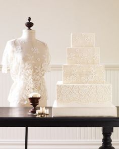 """See the """"Lace Wedding Cake"""" in our  gallery An airy lace from 1900 is reimagined here as a uniquely contemporary cake. The white sugar-paste floral appliques, cut with a craft knife, look almost pixelated when affixed to the nettinglike grid imprinted onto the ivory fondant below. The end result appears delicately antique one second, strikingly futuristic the next. Cake by Ron Ben-Israel Cakes."""