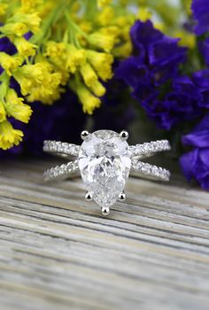 A stunning Pave Split Shank Pear Diamond Ring in White Gold featuring a 2.51 carat pear diamond!