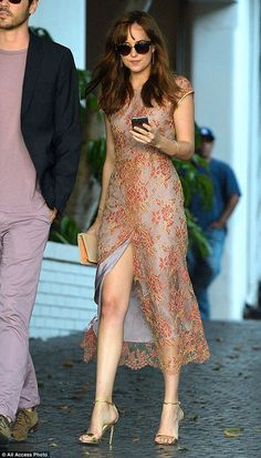 Shady: The 25-year-old actress completed her look with strappy gold heels and Wayfarer sun...