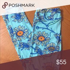 LuLaRoe OS Leggings Worn once LuLaRoe OS Leggings - Soft electric blue w/ Daisies. You'll never wear pants again after trying these buttery soft beauties on. Like ever. These were handled and worn with the utmost care (because LLR is life) a hand full of times. Washed per LLR laws. LuLaRoe Pants Leggings