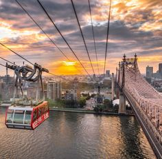 Roosevelt Island Tram as it travels over The East River parallel to the Queensboro Ed Koch Bridge -- NYC