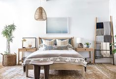 "Yoooooooooo!!!! I designed a furniture line for that other job I have owning a retail store @shoppe_by_ai ... what is one of my faves from the collection???? The ""PENNY"" bed of course!! I have one, and I am obsessed with it. The leather straps on he headboard, and the tone of the white oak.. yep!👍🏼👍🏼 Check out the full blog post showing all the pieces 🤡 // link in profile // #shoppeisdope 📷 @jess_isaac"
