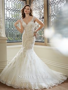 Sophia Tolli - Y11646 – Rana - Misty tulle trumpet gown with slight lace cap sleeves, softly shaped V-neckline, hand-beaded lace appliqué bodice with dropped waist, semi sheer V-back bodice with lace and back zipper both trimmed with diamante buttons, appliqués cascade down skirt with matching scalloped hem lace and chapel length train.  Sizes: 0 – 28  Colors: Ivory/Pewter, White/Pewter