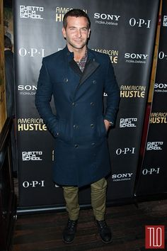 """Bradley Cooper attends the """"American Hustle"""" screening after party at Monkey Bar in New York City in a Tommy Hilfiger trench coat paired with a Todd Snyder plaid shirt."""