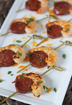 Shrimp and chorizo skewers with a cream cheese jalapeño dipping sauce.