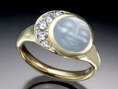 Gold, diamonds, and a MOON.  What more could a girl want on her finger?    --skylightjewelers.com