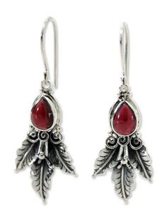NOVICA Garnet .925 Sterling Silver Dangle Earrings 'Temptation'. An original NOVICA fair trade product in association with National Geographic. Includes an official NOVICA Story Card certifying quality & authenticity. NOVICA works with Buana to craft this item. Includes an original NOVICA jewelry pouch to keep for yourself or give as a gift. A keepsake treasure designed to be loved for years to come.