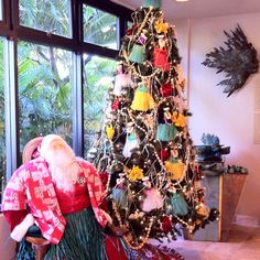 Cute Hawaiian Christmas decor. Love that Santa has a hula skirt on.