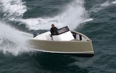 Smartboat 23 - a radical hull shape, easily driven, means both fun & fuel savings; made by the yacht design firm VPLP (best known for designing lg, high performance multihulls for the America's Cup). Smartboat 23 is the official motor boat supplier for the 2011-2012 Global Ocean Race.