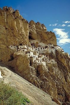 Phugtal Gompa, India. Hanging onto the edge of a rocky gorge at the mouth of a giant cave, this sacred construction is built directly into the cliff side. Phugtal's (Phuktal) 70 or so Buddhist monks live there, dividing their holy time between the monastery's library and prayer rooms.