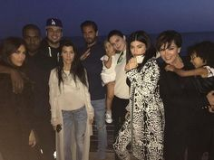 The Kardashian-Jenner family came together on Saturday for a belated (and St. Patrick's Day-themed) birthday bash for brother Rob Kardashian, who turned 29 on Thursday.  Kim Kardashian West, Kourtney Kardashian and Kylie Jenner documented the evening, which included dinner at Nobu Malibu and featured