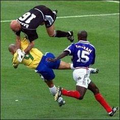awsome soccer photos | Goalie Eric Padegimas '09 makes an amazing save over an opposing ...  Who has the ball???