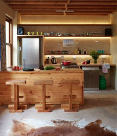 By Simone Borcherding stylist   writer   spacemaker. Eco-friendly kitchen using wood from alien vegitation, opn shelves and cowhide
