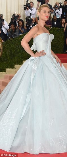 Beautiful in blue! Her baby blue dress had a sweetheart neckline and overflowing skirt that skimmed the floor