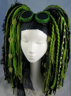 Looks sort of steampunk, may be the goggles...?  Shades of Green/Black Yarn Hair Falls by SicklySweetStyle on Etsy
