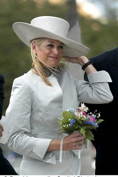 Queen Maxima. Wind and wearing a hat is not a good combi.... But Maxima is holding on.