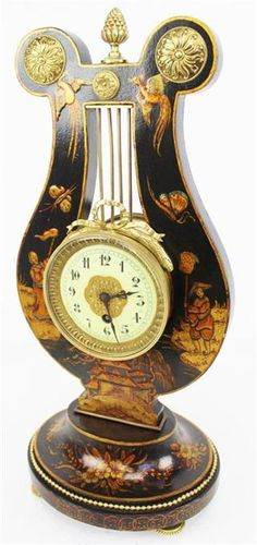 Rare Lyre shaped black Chinoiserie 8 day clock.