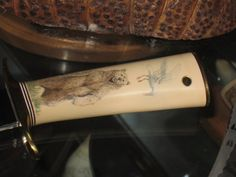 Randall with scrimshaw by  Joe Saggio is on a fossilized mammoth  Randall for Jack Crider one of Randall's largest dealers.   It shows the gull stealing salmon from the grizzly.  This piece was done in the early 90's