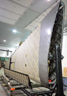 a photo of the detached wing of a Wellington bomber in unpainted state Wellington Bomber, Westland Lysander, Tails Boom, Flying Wing, Royal Air Force, Paint Schemes, Conservation, Ww2, Planes