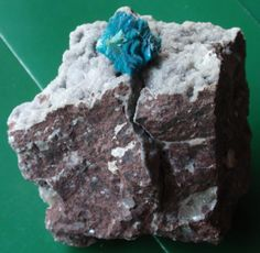 Cavansite coming out of fissure in volcalic rock and standing on microstilbite crystals,India.