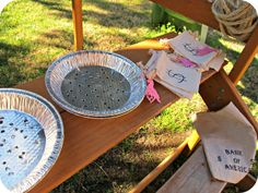 Western Party Games - When the kids first arrived to the party, we sent them to the Trading Post to get gold panning supplies - a pie pan with holes punched in the bottom, and little muslin money bags to collect their treasure.