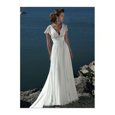 This style dress, with higher crossed over v-neckline, and slightly longer flowy sleeves.