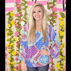 Out of the Blue Top  Can be worn on or off the shoulders! Flowy sleeves and bright paisley/geo print throughout! 100% polyester. Model is 5'4 and wearing a size SMALL! Tops Blouses