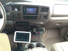 Uniden Cobra CB dash mounted in a Ford Excursion.
