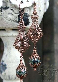 Dark and earthy Czech glass beads with antiqued copper filigree come together perfectly with this pair of drop earrings for pierced ears.     Antiqued copper leverback hooks, lead and nickel free.   Lightweight and easy to wear despite their length   Comes beautifully gift boxed   About 3.5 inches long including hooks.