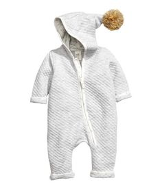 Check this out! CONSCIOUS. Jumpsuit in soft, melange jersey with a quilted pattern. Contrasting trim, jersey-lined hood with large pompom, and zip at front that continues down one leg. Cotton content is organic. - Visit hm.com to see more.