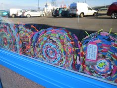 Hula hoop rag rugs woven by children at Rothesay Primary, North Bute Primary and Achievement Bute, displayed in the window at Middleton's Sandwich shop, recipient of Rothesay THI shopfront funding