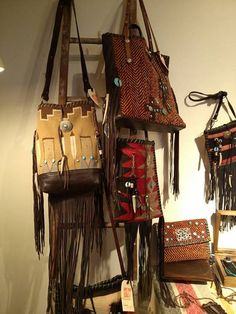 Navajo Handbags made from blankets / rugs, vintage horse tack, and deer, elk or cowhide leathers. I embellish the bags with vintage trade beads, turquoise, coral, nickel silver/German silver Concho buttons, nickel silver spots/studs, and deer antler tips.