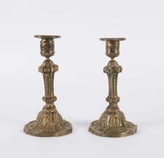 A pair of French gilt bronze candlesticks, circa 1850, 20cm high / MAD on Collections - Browse and find over 10,000 categories of collectables from around the world - antiques, stamps, coins, memorabilia, art, bottles, jewellery, furniture, medals, toys and more at madoncollections.com. Free to view - Free to Register - Visit today. #Bronze #DecorativeArts #MADonCollections #MADonC