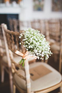 Gyp decorating the aisle chairs | Photography by http://photography34.co.uk/
